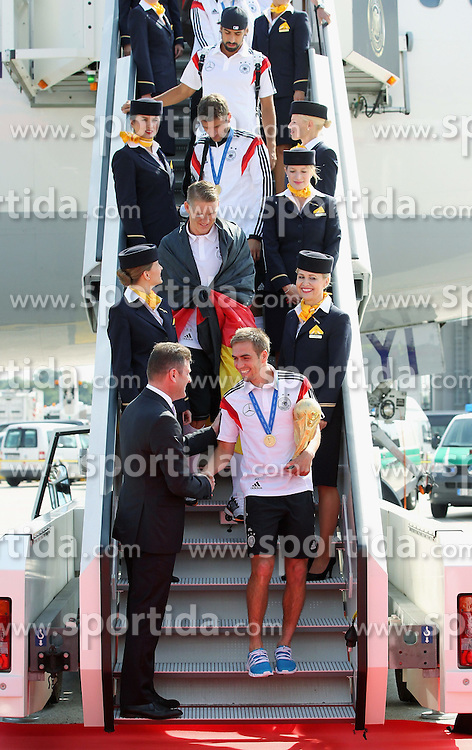 15.07.2014, Flughafen Tegel, Berlin, GER, FIFA WM, Empfang der Weltmeister in Deutschland, Finale, im Bild Philipp Lahm (GER) berlaesst mit dem WM-Pokal die Lufthansamaschine. // during Celebration of Team Germany for Champion of the FIFA Worldcup Brazil 2014 at the Flughafen Tegel in Berlin, Germany on 2014/07/15. EXPA Pictures © 2014, PhotoCredit: EXPA/ Eibner-Pressefoto/ Eibner Pressefoto / pool<br /> <br /> *****ATTENTION - OUT of GER*****