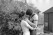 Teresa and Gavin kissing outside. UK. 1980s.