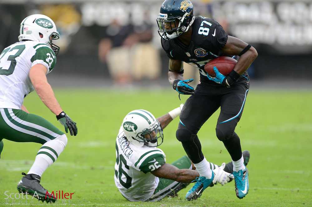 Jacksonville Jaguars wide receiver Anthony Armstrong (87) spins away from New York Jets defensive back Ellis Lankster (26) during an NFL game  at EverBank Field on Dec 9, 2012 in Jacksonville, Florida. The Jets won 17-10...©2012 Scott A. Miller..