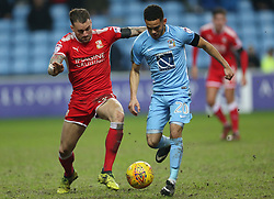 Coventry City's Dion Kelly-Evans and Swindon Town's James Dunne battle for the ball