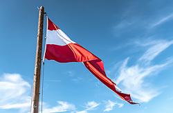 THEMENBILD - die österreichische Fahne flattert im Wind vor blauem Himmel, mit leichten Wolken. Die Grossglockner Hochalpenstrasse verbindet die beiden Bundeslaender Salzburg und Kaernten und ist als Erlebnisstrasse vorrangig von touristischer Bedeutung, aufgenommen am 02. Juni 2019 in Fusch a. d. Grossglocknerstrasse, Österreich // the Austrian flag flutters in the wind before blue sky, with light clouds. The Grossglockner High Alpine Road connects the two provinces of Salzburg and Carinthia and is as an adventure road priority of tourist interest, Fusch a. d. Grossglocknerstrasse on 2019/06/02, Kaprun, Austria. EXPA Pictures © 2019, PhotoCredit: EXPA/ Stefanie Oberhauser