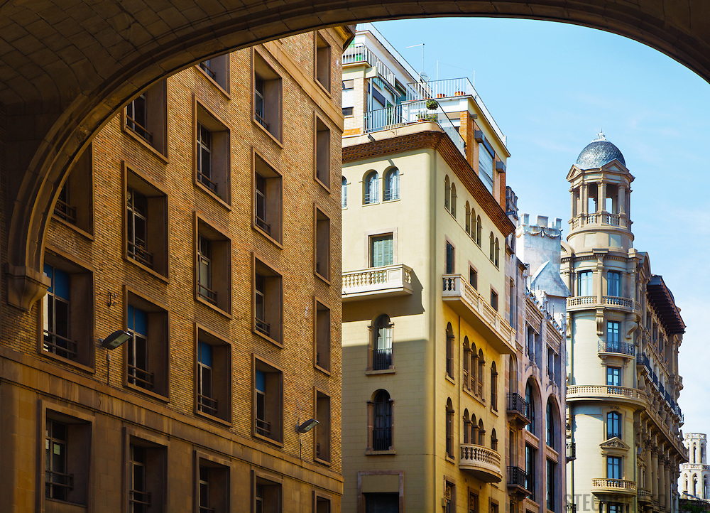 A row of business and apartment buildings on the edge of the Gothic Quarter in Barcelona, Spain.<br />