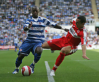 Photo: Lee Earle.<br /> Reading v Middlesbrough. The Barclays Premiership. 19/08/2006. Reading's Leroy Lita (L) battles with Emanuel Pogatetz.