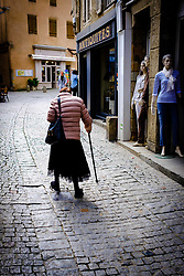 An old lady walks in the Rue Cros Mayrevielle in the medieval  Cit&eacute; de Carcassonne, France<br /> <br /> (c) Andrew Wilson   Edinburgh Elite media