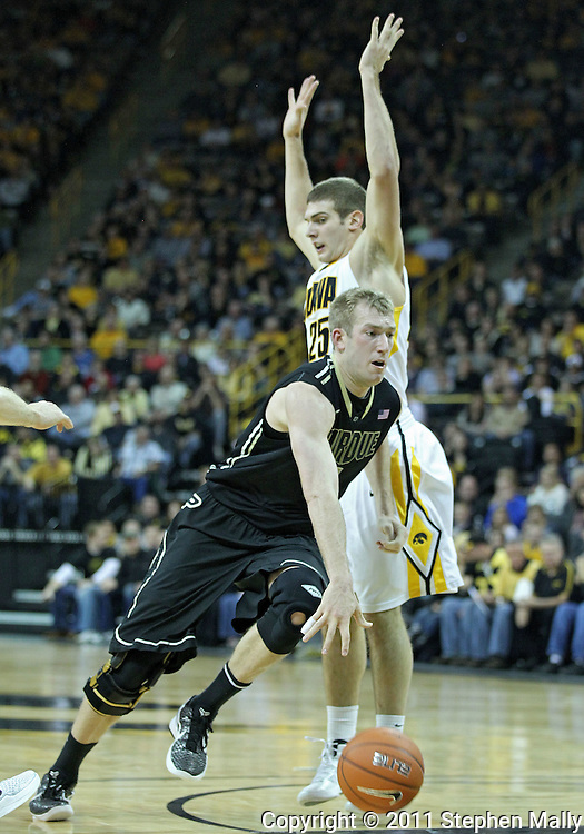 December 28, 2011: Purdue Boilermakers forward Robbie Hummel (4) drives around Iowa Hawkeyes guard/forward Eric May (25) to the basket during the NCAA basketball game between the Purdue Boilermakers and the Iowa Hawkeyes at Carver-Hawkeye Arena in Iowa City, Iowa on Wednesday, December 28, 2011. Purdue defeated Iowa 79-76.