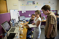Getup office in Sydney. R to L Alex Cooper Technoligist, Gillian Kramer Executive officer and Francois Chemillier online campaigner.