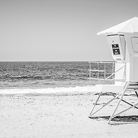 Laguna Beach California Lifeguard Tower black and white panoramic photo with a wooden boardwalk at Main Beach. Laguna Beach is a beach community along the Pacific Ocean in Orange County Southern California.