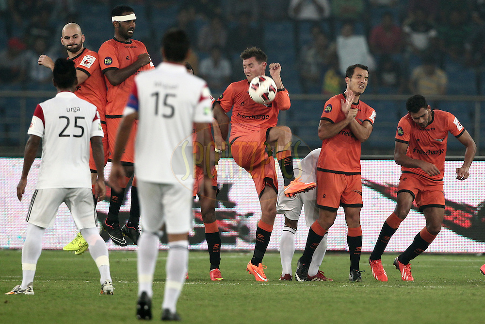 Delhi Dynamos FC Player make a wall during free kick match 16 of the Hero Indian Super League between The Delhi Dynamos FC and NorthEast United FC held at the Jawaharlal Nehru Stadium, Delhi, India on the 29th October 2014.<br /> <br /> Photo by:  Deepak Malik/ ISL/ SPORTZPICS