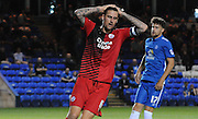 Sonny Bradley can't quite believe his chance went wide during the Capital One Cup match between Peterborough United and Crawley Town at London Road, Peterborough, England on 11 August 2015. Photo by Michael Hulf.