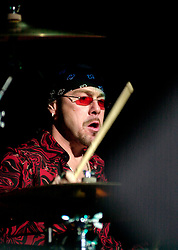 Quireboys drummer Jason Bonham (who is the son of Legendary Led Zeppelin Drummer John Bonham and has replaced outgoing Martin Henderson who quit the band in October 2002)at the Monsters of Rock Festival. Last night of an eleven date tour at the Hallam FM Arena, Sheffield Tuesday 26th November 2002<br /> <br /> Copyright Paul David Drabble<br /> Freelance Photographer<br /> 07831 853913<br /> 0114 2468406<br /> www.pauldaviddrabble.co.uk<br /> [#Beginning of Shooting Data Section]<br /> Nikon D1 <br /> 2002/11/26 20:13:58.4<br /> JPEG (8-bit) Fine<br /> Image Size:  2000 x 1312<br /> Color<br /> Lens: 80-200mm f/2.8-2.8<br /> Focal Length: 135mm<br /> Exposure Mode: Manual<br /> Metering Mode: Spot<br /> 1/250 sec - f/2.8<br /> Exposure Comp.: 0 EV<br /> Sensitivity: ISO 400<br /> White Balance: Auto<br /> AF Mode: AF-S<br /> Tone Comp: Normal<br /> Flash Sync Mode: Front Curtain<br /> Auto Flash Mode: External<br /> Color Mode: <br /> Hue Adjustment: <br /> Sharpening: Normal<br /> Noise Reduction: <br /> Image Comment: <br /> [#End of Shooting Data Section]
