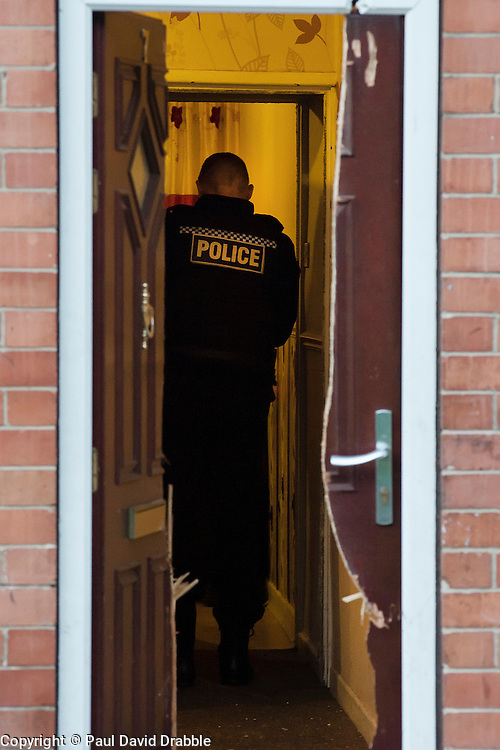 After a forced entry using a chainsaw South Yorkshire Police Officers execute a Warrant at an address in Eastwood Rotherham early on Tuesday Morning<br /> <br /> 04 March 2014<br /> Image &copy; Paul David Drabble <br /> <br /> www.pauldaviddrabble.co.uk
