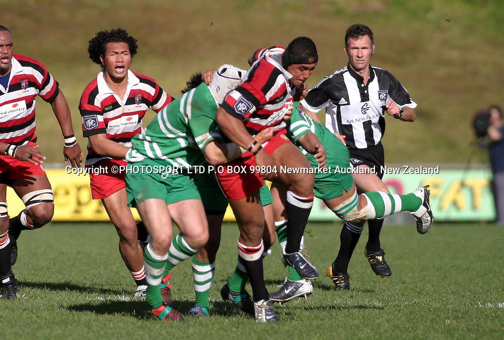 Sisa Koymobile goes on a rampaging run and it takes 3 Manawatu defenders to tie him up.<br />NPC Counties Manukau Vs Manawatu, The Growers Stadium, Pukekohe, Saturday August 7. Counties def Manawatu 40 - 32. <br />PHOTO: Richard Spranger / PHOTOSPORT
