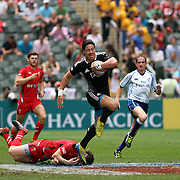 Ben Lam breaks for NZ's first try of their game vs Wales.  New Zealand All Blacks decisively defeated Wales 28-5 on the 3rd day of the Hong Kong Sevens, Hong Kong. Photo by Barry Markowitz, (Courtesy STP/TriMarine) 3/20/14, 12:12 pm