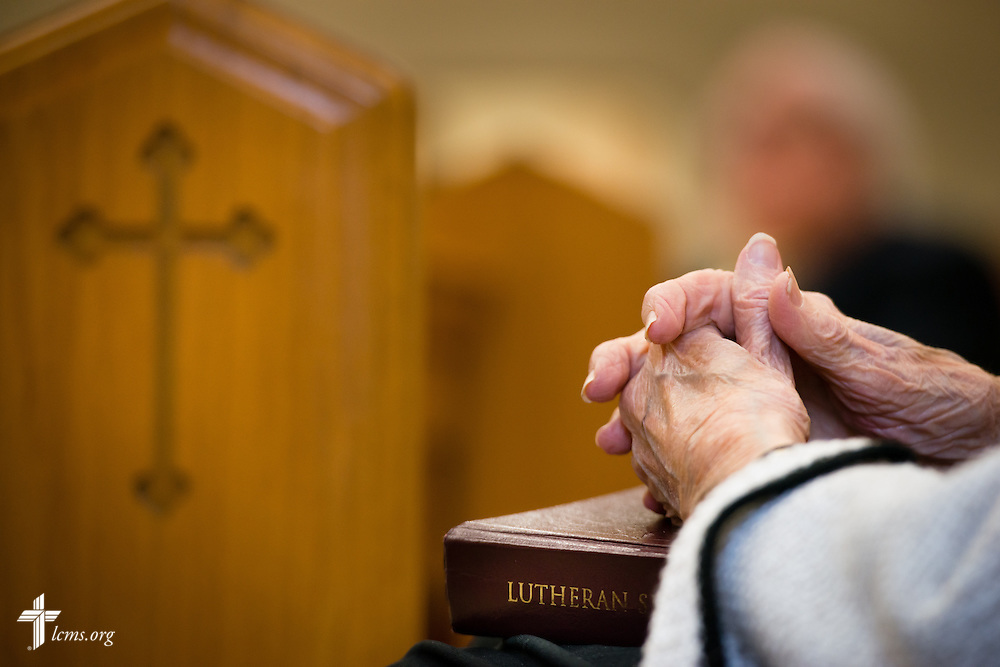 A parishioner clasps her hands at Divine Service on Sunday, Nov. 23, 2014, at Living Faith Lutheran Church in Cumming, Ga. LCMS Communications/Erik M. Lunsford