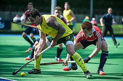 Australia's Kieran Govers holds off Henry Weir of England. England v Australia, Bisham Abbey, Marlow, UK on 25 May 2014. Photo: Simon Parker