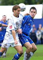 Photo: Dave Linney.<br />Chasetown v Oldham Athletic. The FA Cup. 06/11/2005.Karl Edwards(Chasetown/right) battles for the ball with Danny Hall(Oldham)