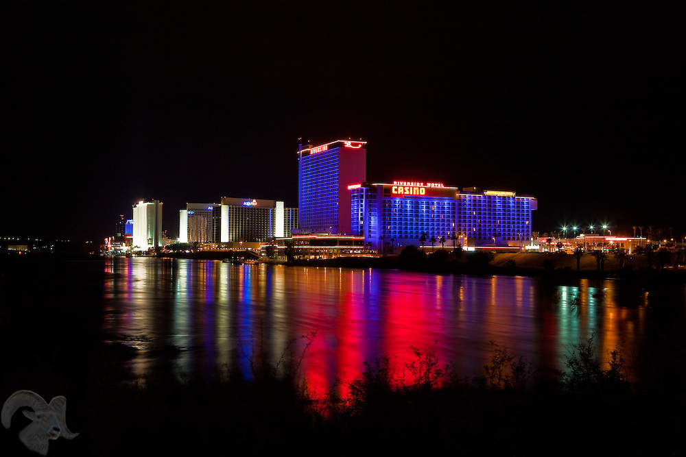 A vivid reflection of the City of Laughlin, Nevada shines in the Colorado River.