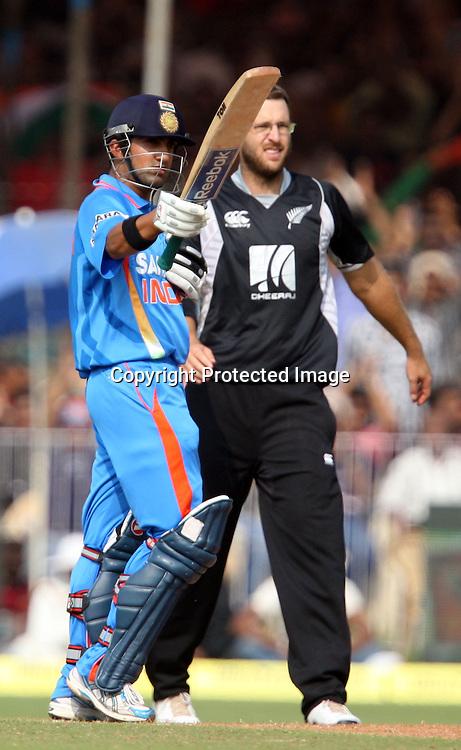Indian captain Gautam Gambhir celebrates half century against New Zealand during the 3rd ODI India vs New Zealand Played at Reliance Stadium, Vadodara<br /> 4 December 2010 (50-over match)