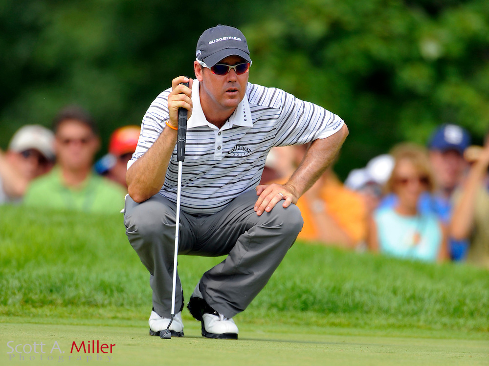 Aug 13, 2009; Chaska, MN, USA; Rich Beem (USA) lines up a putt on the second hole during the first round of the 2009 PGA Championship at Hazeltine National Golf Club.  ©2009 Scott A. Miller