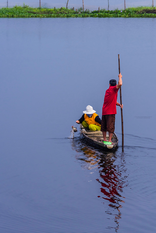 People fishing in the countryside near Hue, Central Vietnam.