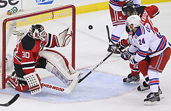May 19, 2012; Newark, NJ, USA; New Jersey Devils goalie Martin Brodeur (30) makes a save while New Jersey Devils defenseman Bryce Salvador (24) and New York Rangers right wing Ryan Callahan (24) battle for the rebound during the second period in game three of the 2012 Eastern Conference Finals at the Prudential Center.