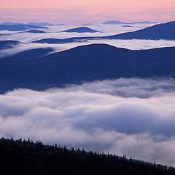 From Sugarloaf Mtn. Sunrise, undercast, fog. Nash Stream State Forest.   Northern Forest. Cohos Trail.  Stratford, NH