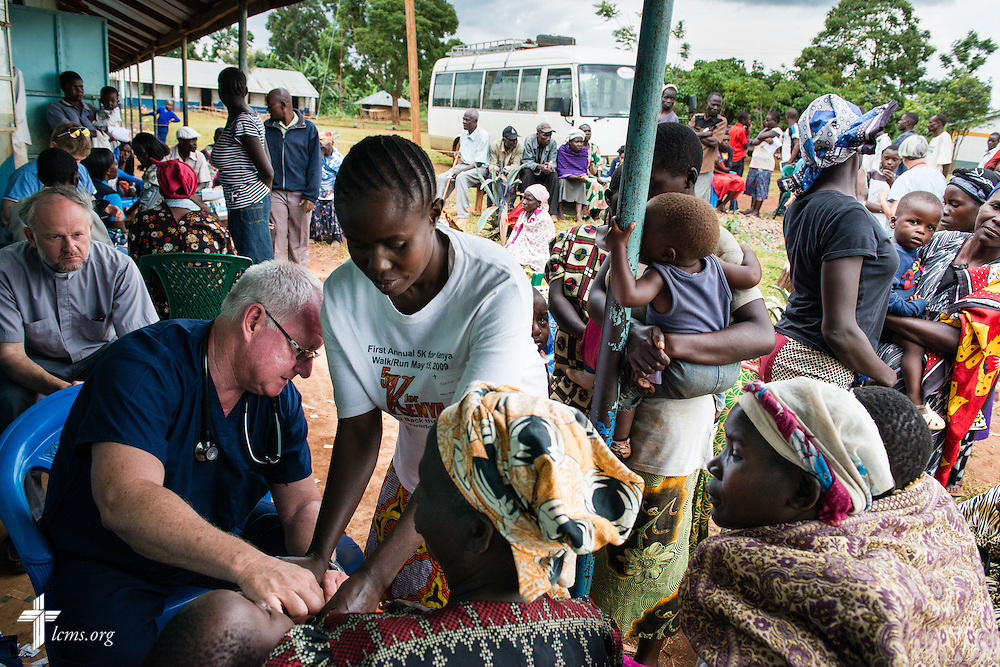 Tom Andrews of Wentzville, Mo., attending Immanuel Lutheran Church, checks vitals as he works in the intake area of the Mercy Medical Team clinic on Tuesday, June 10, 2014, at the Luanda Doho Primary School in Kakmega County, Kenya. LCMS Communications/Erik M. Lunsford