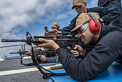 May 20, 2019 - Atlantic Ocean - Navy Petty Officer 2nd Class Richard Woodland fires an M4 rifle during a small-arms weapons qualification course aboard the guided missile destroyer USS Carney in the Atlantic Ocean, May 20, 2019. (Credit Image: © U.S. Navy/ZUMA Wire/ZUMAPRESS.com)
