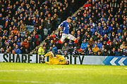 Kyle Lafferty of Rangers leaps over an advancing Gary Woods of Hamilton Academical FC during the Ladbrokes Scottish Premiership match between Rangers and Hamilton Academical FC at Ibrox, Glasgow, Scotland on 16 December 2018.