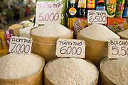 09 MARCH 2006 - HO CHI MINH CITY, VIETNAM: Different grades of rice for sale in the market in Ho Chi Minh City (Saigon), Vietnam. Rice is a staple in many southeast Asian countries and as prices have skyrocketed some countries (including Vietnam) have restricted exports of rice so they can be sure of meeting their domestic needs.    PHOTO BY JACK KURTZ