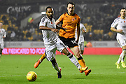 Fulham defender Dennis Odoi (4) holds off Wolverhampton Wanderers midfielder Diogo Jota (18) 2-0 during the EFL Sky Bet Championship match between Wolverhampton Wanderers and Fulham at Molineux, Wolverhampton, England on 3 November 2017. Photo by Alan Franklin.