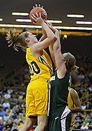 January 27 2010: Iowa forward Kelly Krei (20) puts up a shot over Michigan St. forward Taylor Alton (33) during the first half of an NCAA women's college basketball game at Carver-Hawkeye Arena in Iowa City, Iowa on January 27, 2010. Iowa defeated Michigan State 66-64.