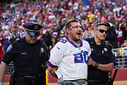 A bloodied New York Giants fan fought [and lost] with police during a NFL game between the San Francisco 49ers and the New York Giants at Levi's Stadium in Santa Clara, Calif., on November 12, 2017. (Stan Olszewski/Special to S.F. Examiner)