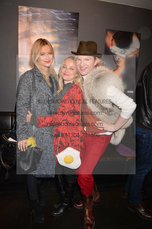 Left to right, Laura Whitmore, Erica Bergsmeds and Henry Conway at an exhibition of photographs by Erica Bergsmeds held at The Den, 100 Wardour Street, London England. 19 January 2017.