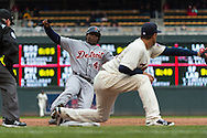 Torii Hunter #48 of the Detroit Tigers slides into 3rd base before being tagged out by Trevor Plouffe #24 of the Minnesota Twins on April 3, 2013 at Target Field in Minneapolis, Minnesota.  The Twins defeated the Tigers 3 to 2.  Photo: Ben Krause