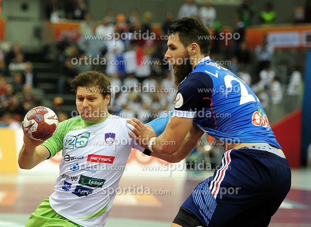 Marko Bezjak #25 of Slovenia vs Luka Karabatić of France during handball match between National Teams of Slovenia and France at Day 14 in Quarter Finals of 24th Men's Handball World Championship Qatar 2015 on January 28, 2015 in Ali Bin Hamad Al-Attiyah Arena, Doha, Qatar. Photo by Slavko Kolar / Sportida