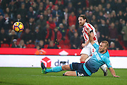 Stoke City midfielder Joe Allen (4) shot sets up the third goal for Stoke City forward, on loan from Manchester City, Wilfried Bony (12)   during the Premier League match between Stoke City and Swansea City at the Britannia Stadium, Stoke-on-Trent, England on 31 October 2016. Photo by Simon Davies.