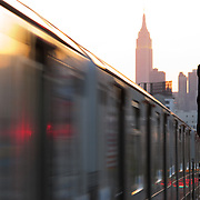 Empire State Building and Midtown Manhattan at sunset with Seven Line subway train, from Sunnyside, Queens, New York, NY