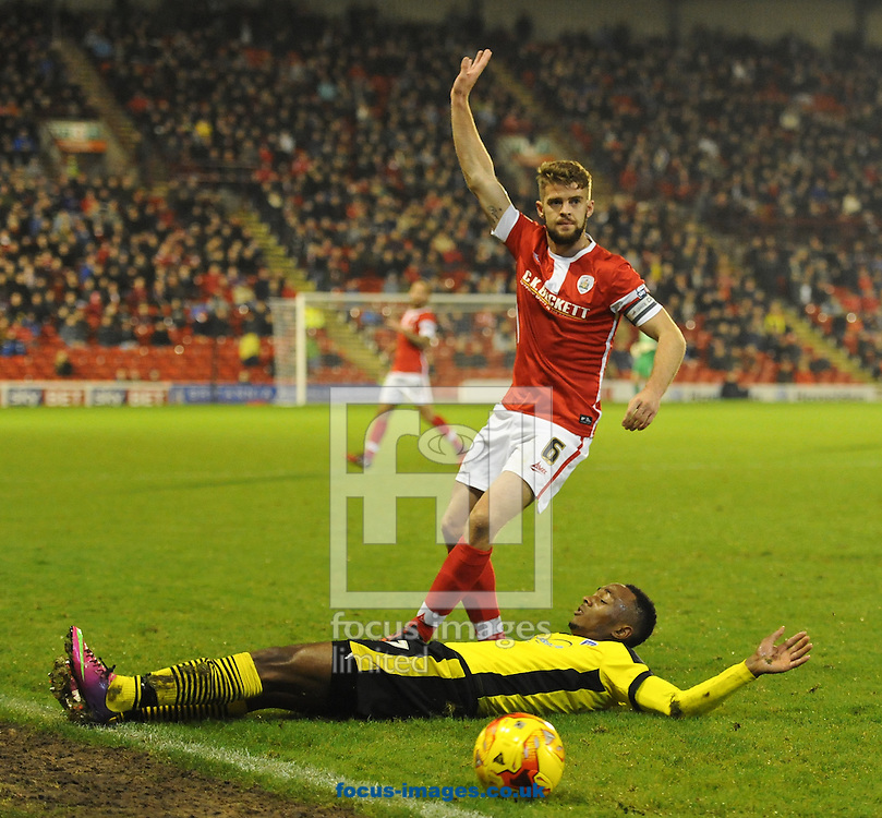 Sanchez Watt of Colchester United tries to get away from Martin Cranie but is brought down during the Sky Bet League 1 match at Oakwell, Barnsley<br /> Picture by Richard Land/Focus Images Ltd +44 7713 507003<br /> 14/11/2014