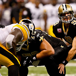 Oct 31, 2010; New Orleans, LA, USA; New Orleans Saints quarterback Drew Brees (9) under center during a game against the Pittsburgh Steelers at the Louisiana Superdome. The Saints defeated the Steelers 20-10.  Mandatory Credit: Derick E. Hingle
