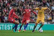 Tomas Rogic (Australia) holds off Jordan Henderson (England) during the Friendly International match match between England and Australia at the Stadium Of Light, Sunderland, England on 27 May 2016. Photo by Mark P Doherty.