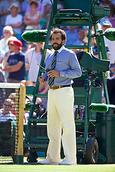 03.07.2014, All England Lawn Tennis Club, London, ENG, WTA Tour, Wimbledon, Tag 10, im Bild Chair umpire Kader Nouni halts the game in the first set tie-break to call for medical assistant for a spectator who was taken ill during the Ladies' Singles Semi-Final match on day ten // during day 10 of the Wimbledon Championships at the All England Lawn Tennis Club in London, Great Britain on 2014/07/03. EXPA Pictures &copy; 2014, PhotoCredit: EXPA/ Propagandaphoto/ David Rawcliffe<br /> <br /> *****ATTENTION - OUT of ENG, GBR*****