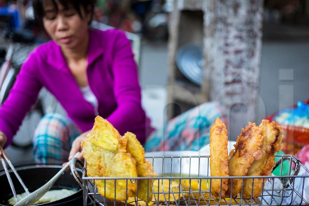A Vietnamese woman cooks Banh Chuoi, Hanoi, Vietnam, Southeast Asia