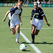 UNCW's Meg Kiser and Longwood's Jayden Metzger give chase to a lose ball.