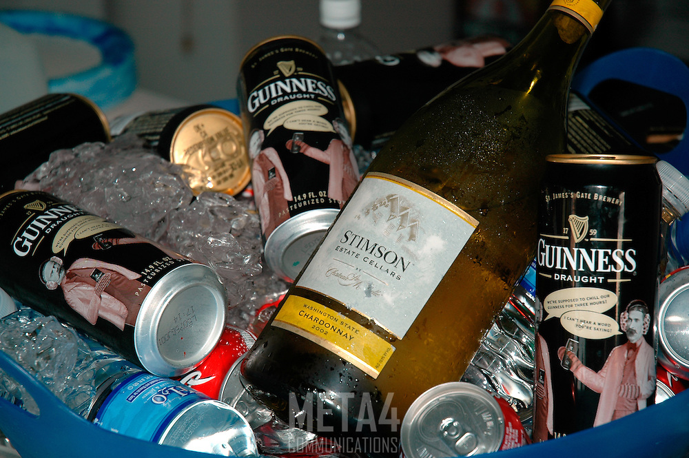 A tempting array of beer, wine and soda chilling in a bucket of ice ready for the party guests.