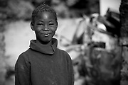 Ten year old Malian girl Mariam Coulibaly poses for a photograph in the street in which she lives in Diabaly, Mali 26 January 2013. This photograph is part of a picture package of portraits showing children living along the same street in the small rice growing community of the northern Malian town of Diabaly who in the month of January 2013 lived through a rapid chain of events in the Malian war.