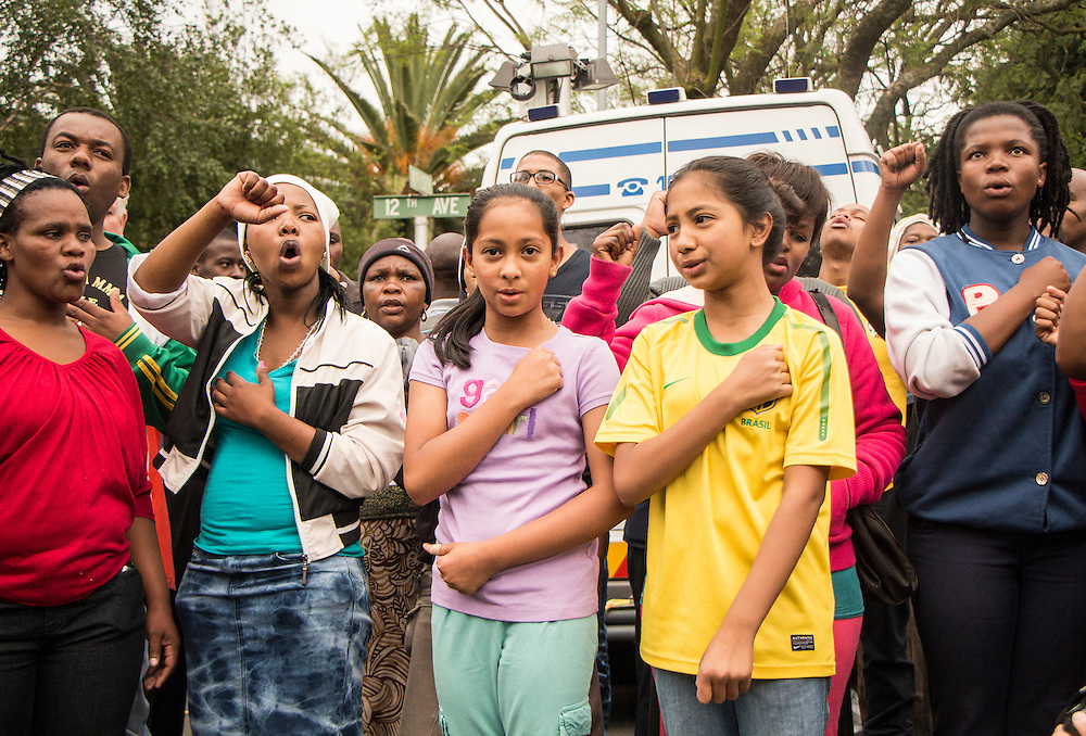 People gathering Nelson Mandela's house in Houghton, Johannesburg singing the South African National Anthem, on Friday Dec. 6th 2013.