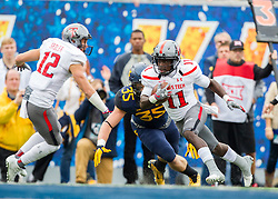 Nov 7, 2015; Morgantown, WV, USA; Texas Tech Red Raiders wide receiver Jakeem Grant catches a pass and runs in for a touchdown during the first quarter against the West Virginia Mountaineers at Milan Puskar Stadium. Mandatory Credit: Ben Queen-USA TODAY Sports
