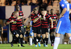 Peterborough United's Tommy Rowe celebrates scoring the third goal with team-mates  - Photo mandatory by-line: Joe Dent/JMP - Tel: Mobile: 07966 386802 06/08/2013 - SPORT - FOOTBALL - Weston Homes Community Stadium - Colchester -  Colchester United V Peterborough United - Capital One Cup - First Round