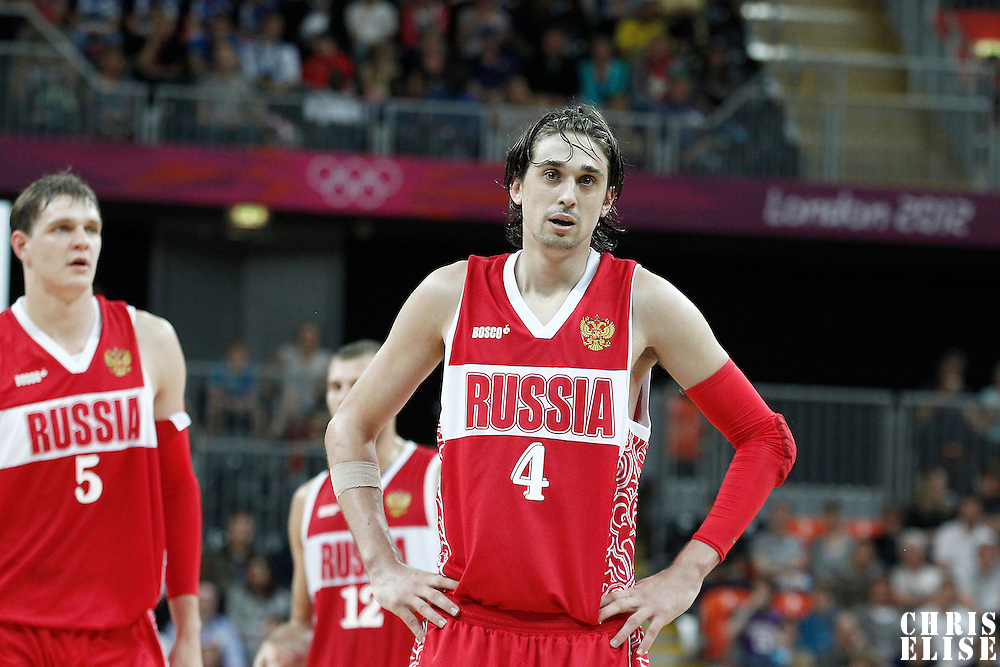 02 August 2012: Russia Alexey Shved rests during 75-74 Team Russia victory over Team Brazil, during the men's basketball preliminary, at the Basketball Arena, in London, Great Britain.